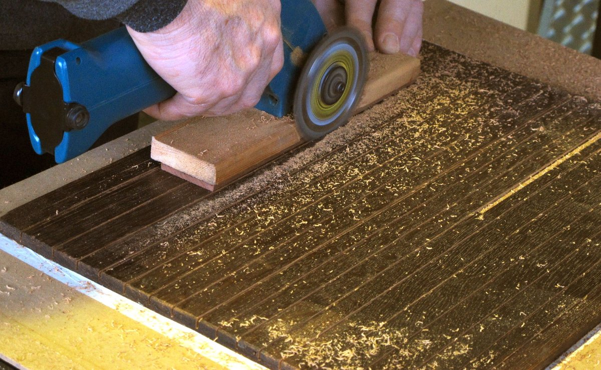 The panel is sawed on part of its thickness